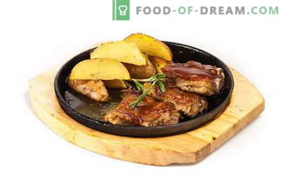 Côtes de porc avec pommes de terre au four - moelleuses, juteuses et délicieuses! Côtes de porc aux pommes de terre au four: recettes