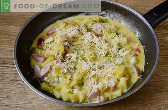 Gekookte aardappelen met een ei in een pan - een voedzaam gerecht van